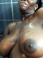 Bosomy ebony mature naked in the shower..