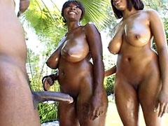 Two busty ebony lesbians hardcore fucked in wild group sex