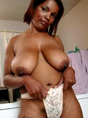 Depraved ebony whores flashing tits and..