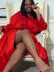 Black Mom in black silk robe with a big..
