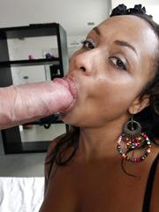 Slutty ebony milf sucking big black dick