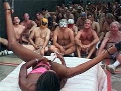 Wild black slut Mocha Delight masturbating her pussy in the presence of 100 hungry mans. Really..